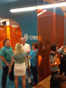 People mingling at Flywheel Open House